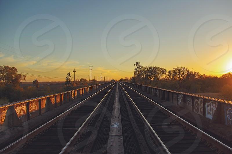 train tracks sunset photo photo