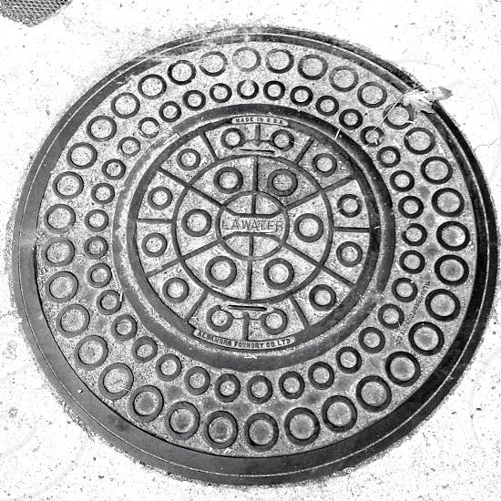 metal la water sewer lid photo