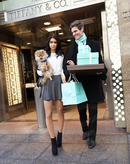 man and woman from tiffany and co. store while woman holding tan pomeranian photo