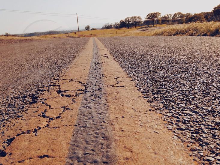 asphalt road across the wheatfields photo