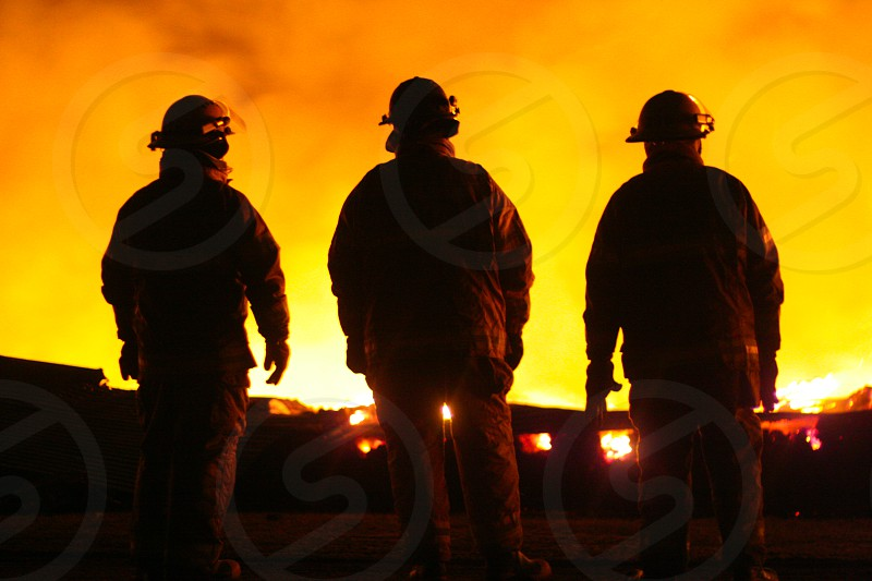 firefighter volunteer fire structure fire hot flames burning maine photo
