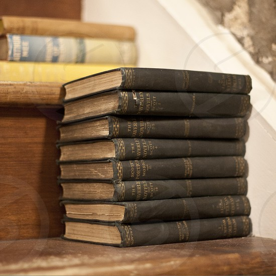 Close-up of old antique books piled on a staircase. photo