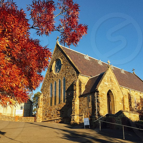 church old stone building autumn fall tree red foliage religion photo