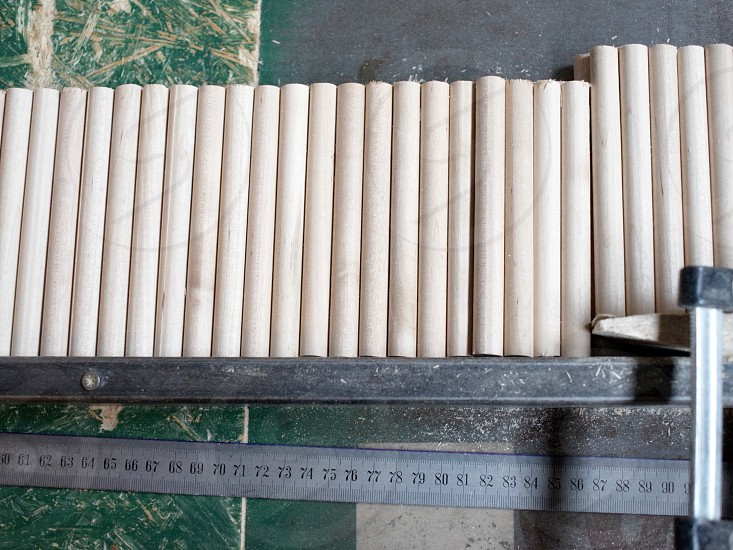 Desk in the factory producing wood sticks. photo