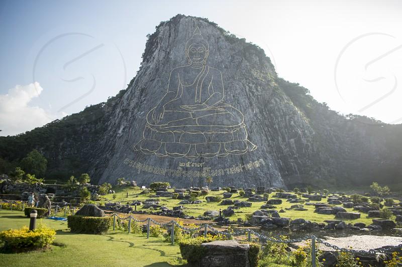 the Buddha Cliff of Khao Chee Chan at the illage of Sattahip near the city of Pattaya in the Provinz Chonburi in Thailand.  Thailand Pattaya November 2017 photo