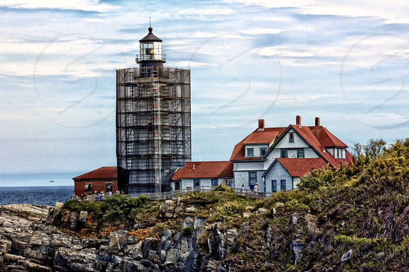 Shot of Portland Headlight lighthouse in Cape Elizabeth the lighthouse being renovated. photo