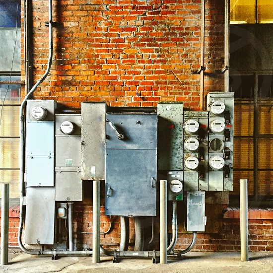 Electric meters against a brick wall. photo