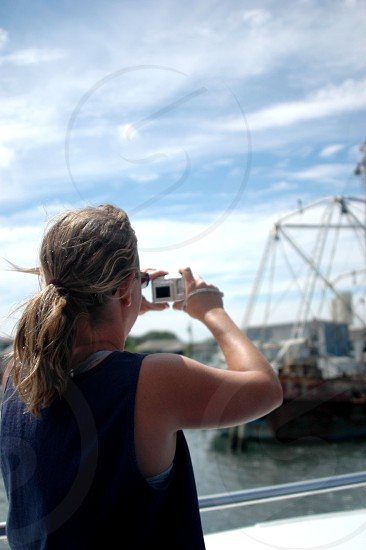 Woman taking pictures of boats photo