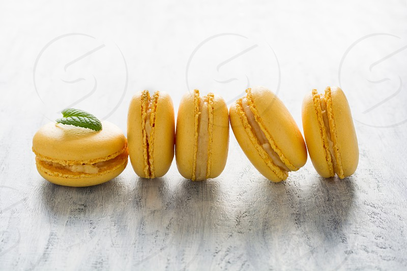 macaroons cookies food sweets selective focus spring color yellow mint leaf photo