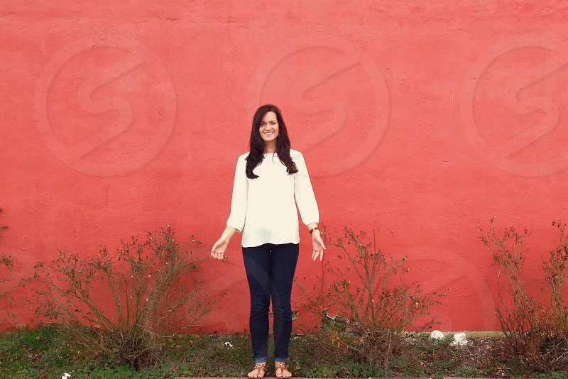 woman in white long sleeved shirt and blue denim jeans photo