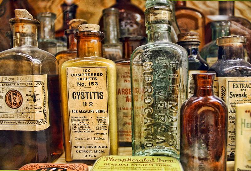 A collection of vintage medicine bottles photo