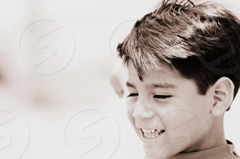 grayscale photography of boy smiling photo