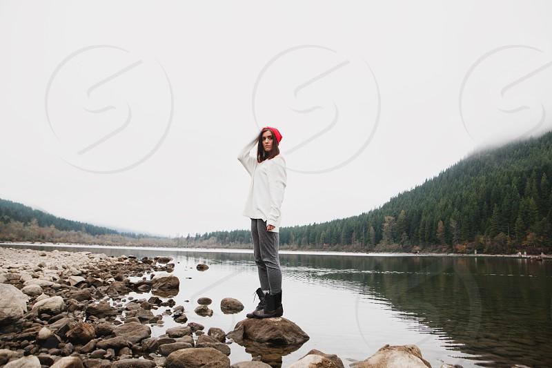 woman standing near lake photography  photo