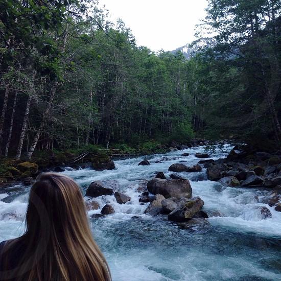woman watching river photo photo