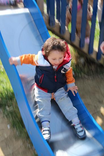baby boy in slide photo