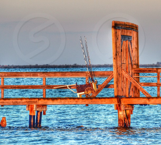 Gone fishing fish cart private dock pier gatedgate closed water sky horizon wood fishing poles photo