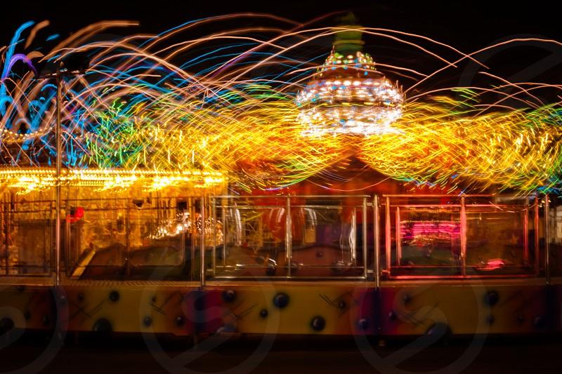 carnival ride long exposure night amusement fun fair festival recreation photo