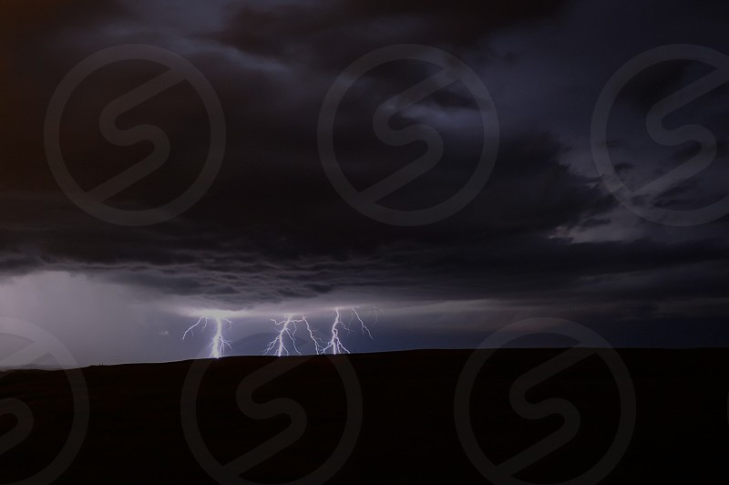 Single shot of one of the most intense lightning storms I've ever chased. I captured this photo on September 30 2014 near Paxico KS. photo