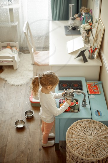 Little girl playing in her room photo