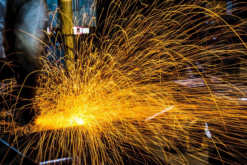 sparks from steel grinding in a factory photo