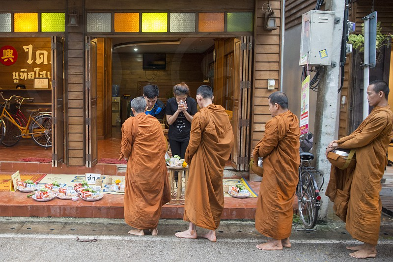 monks in the morning in the old town of Chiang Khan in Isan in north east Thailand photo