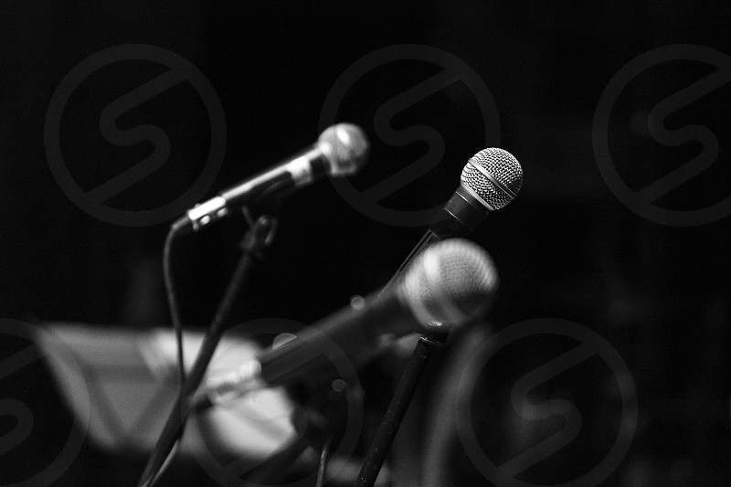 Three microphones used during a musical concert. photo