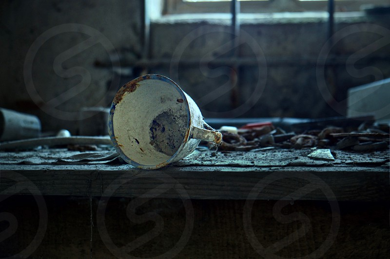 Isolated cup in abandoned place near Bologna Italy photo