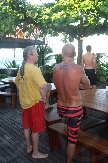 All cultures unite. A hippy defense attorney and a blue collar aussie bonding over surf photo