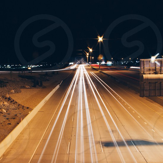white street lights by the road photo