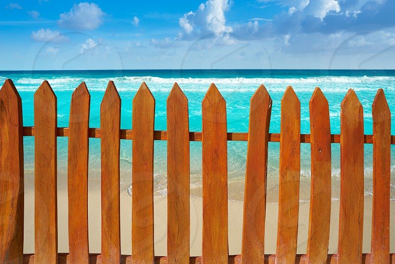Caribbean island wooden fence in turquoise beach photo