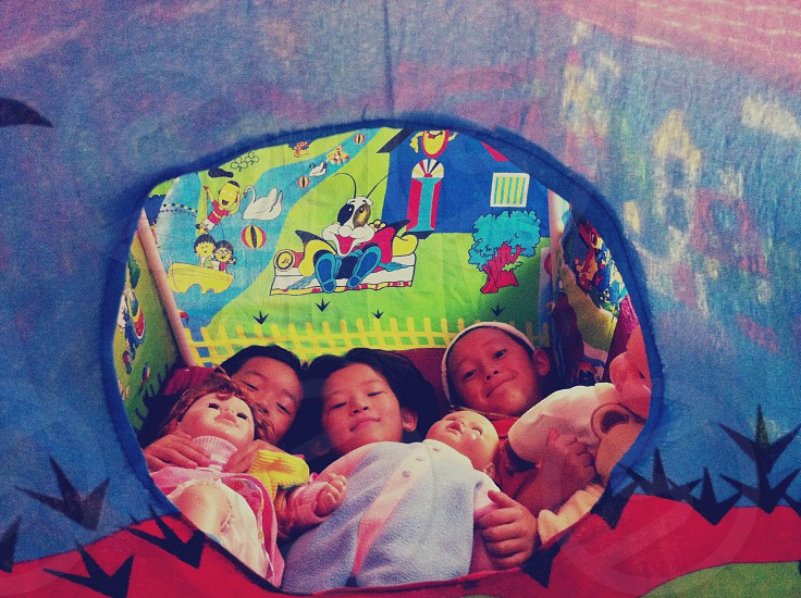 Sleep time inside their small tent.. photo