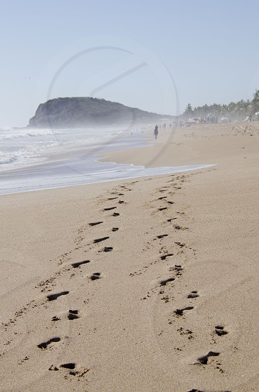 Footsteps at the beach photo