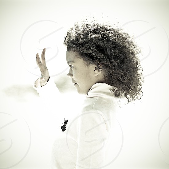 girl with curly hair in white top with black accents photo
