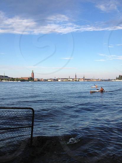 man kayaking on beach  photo