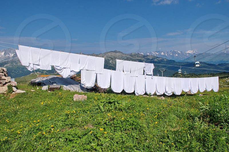 Clothes and sheets drying in the sun on mountain hut in Brenta Dolomites Italy photo