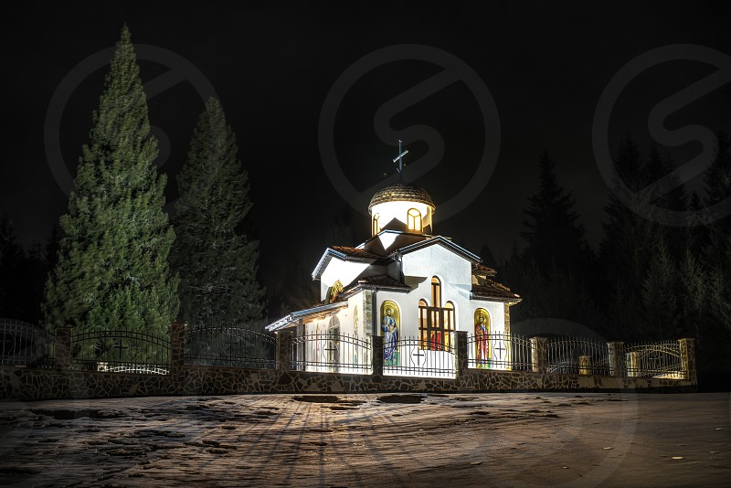 Ortodox church in mountain in the night photo