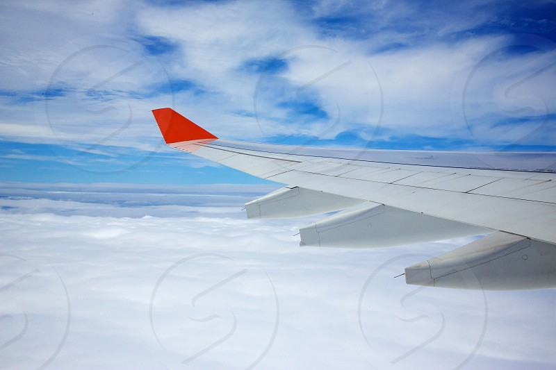 Up in the air  sky clouds plane wing photo