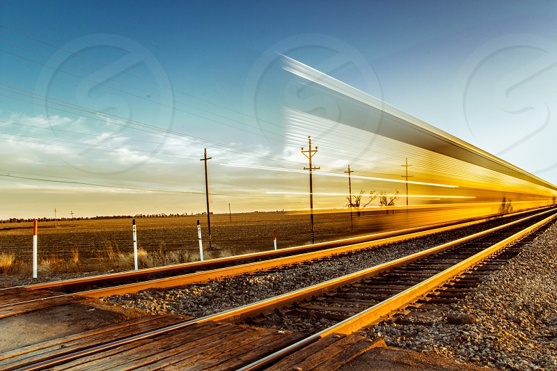 Sunset reflected off a passing train.  photo