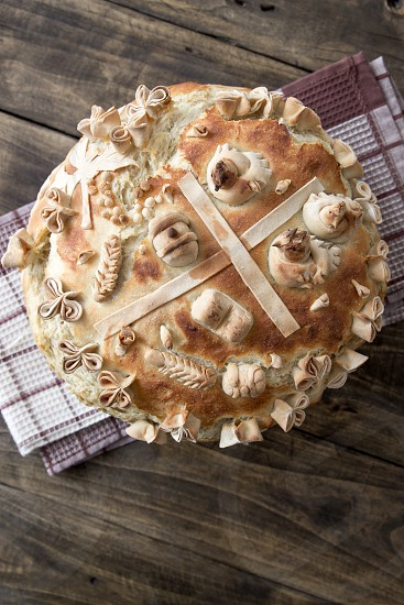 Festive bakery Holiday Bread on wooden table photo
