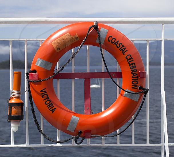 orange round life buoy photo