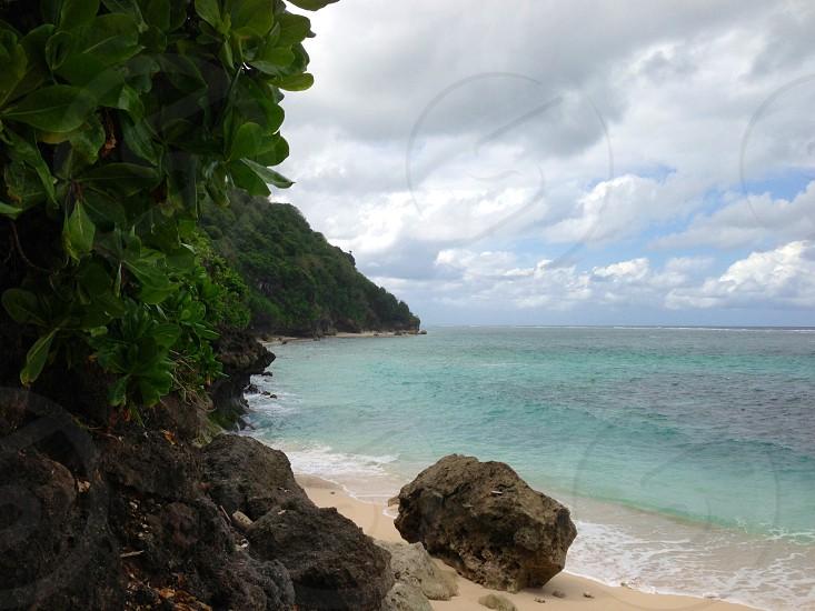 green rocks near seashore photo