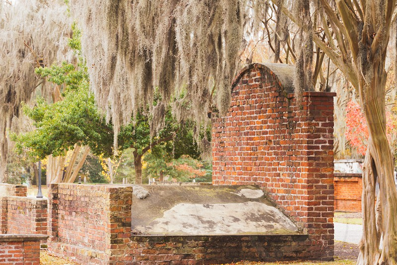 Old masoned brick grave in Colonial Park Cemetery graveyard in Historic District of downtown city of Savannah Georgia GA USA photo