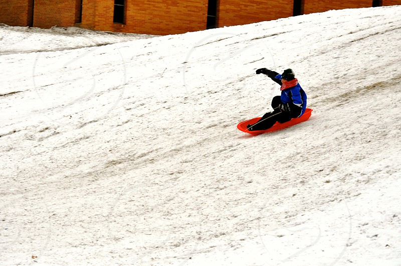 Sledding at the top of the hill - Muncie Indiana - USA photo