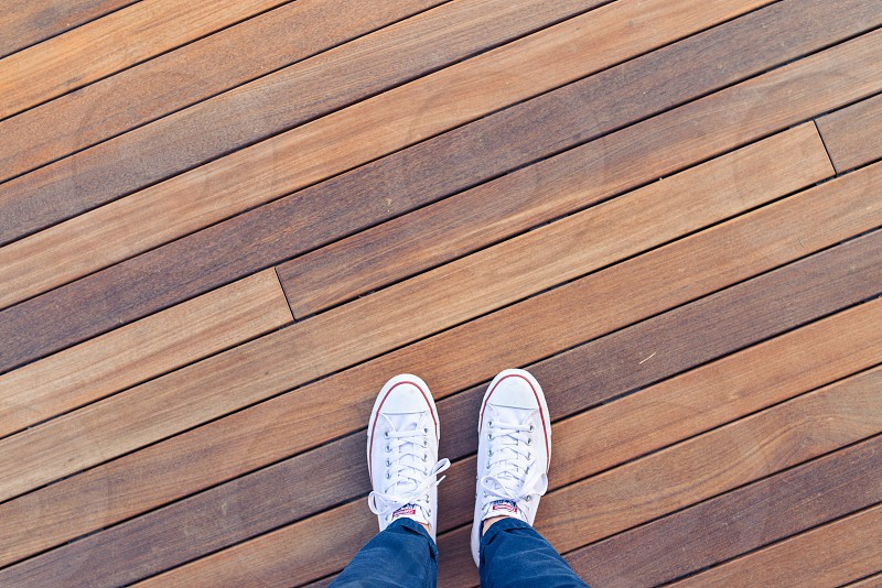 white shoes wood lines flooring photo