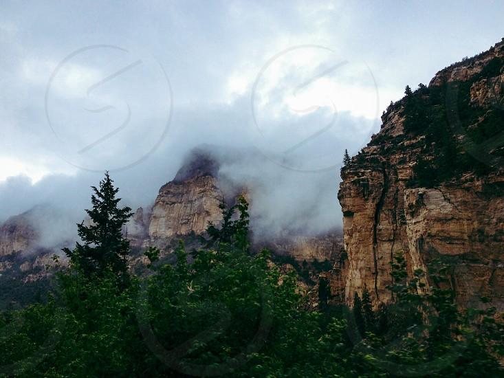 Half fog covered mountain photo