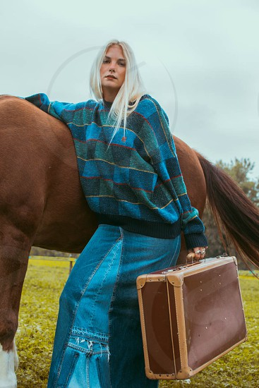 The wilderness was so fascinating she decided to pack carry her vintage suitcase and move with her wild horse. photo