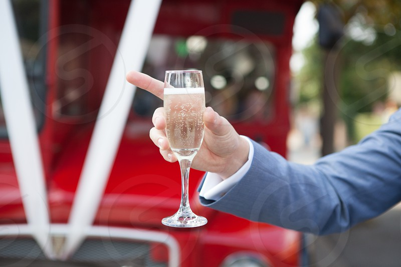 champagne glass hand point holding pointing bubbly sparkling cava prosecco wine red bus vintage arm photo