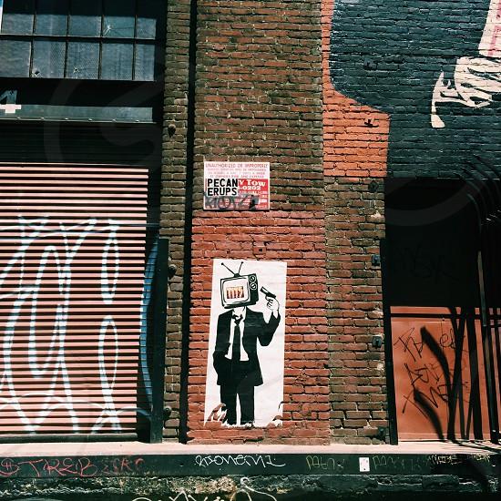 street art on brown red brick wall photo