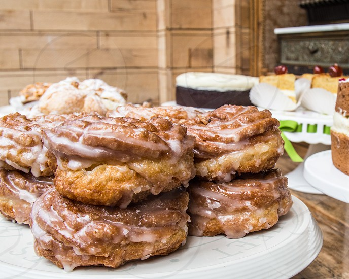 Delicious cruller donuts (doughnuts) on a plate. photo