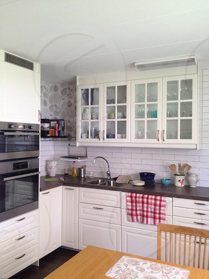 white cupboards in kitchen photo